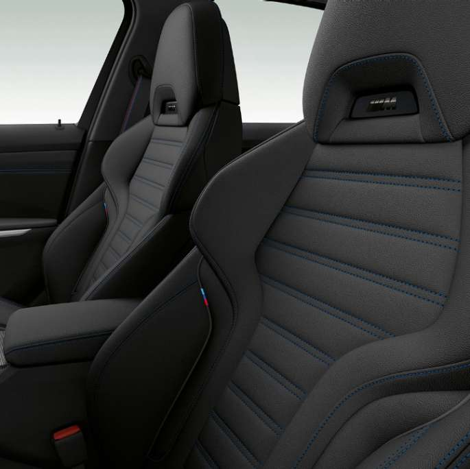Side close-up of the front seats of the BMW 3 Series Sedan with Model M Sport features.